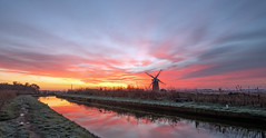 Sunrise at Horsey Mill (Geoffrey Tibbenham) Tags: norfolk broads horsey mill sky sunrise outdoor openspace countryside countryfile clouds colour river reflection water windmill weather fuji zeiss 12mm touit frosty