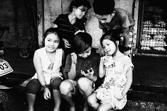 Playmates (Meljoe San Diego) Tags: meljoesandiego fuji fujifilm x100f streetphotography smartphone children candid monochrome philippines