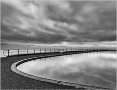 Storm over the paddling pool (Charles Connor) Tags: reflections llandudnopaddlingpool llandudno northwales monochromelandscape monochrome contrast canondslr longexposurephotography