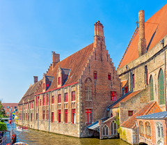 St. John's Hospital, Bruges (Ray in Manila) Tags: belgium architecture ancient boat church colourful eos650d efs24mm europe historical historic hospital medieval flemish placeofworship city water hospitalofstjohn oudsintjanshospitaal churchofourlady 12thcentury monastery convent bruges