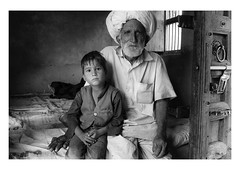a grandfather's love (handheld-films) Tags: india rural rajasthan interior home house portrait portraiture people man boy grandfather grandson generations family monochrome blackandwhite travel