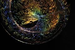 Iridescent Glass Globe (with a little inside twist) (j.towbin ©) Tags: allrightsreserved© macro glass iridescent globe glassglobe img9354 macromondays picktwo ef100mmf28lisusmmacro