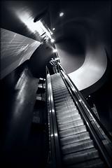 rising to power (bostankorkulugu) Tags: alfaromeo museostoricoalfaromeo alfaromeomuseum museum walk man escalator stairs milan milano italy italia lombardy lombardia rho