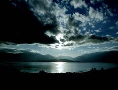 Te Anau  (MF Pro400H) (Harald Philipp) Tags: newzealand fiordland teanau pentax645 pentax64n fujifilm pro400h film analog sunset landscape nature lake clouds sun reflection mountains crepuscular water sky blue