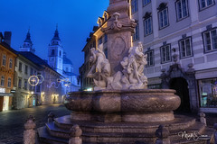 The Ljubljana old square... (marko.erman) Tags: ljubljana slovenia slovenija christmas illuminated beautiful city morning sony night light colors bâtiment nuit ciel ljubljanica ville triple river longexposure wideangle newyear oldsquare staritrg robba fountain church sculpture fountainofthethreecarniolanrivers illuminations decoration travel popular outdoor outside