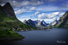 The enchanting setting of Reine (marko.erman) Tags: lofoten norway nordland reine village fishermen sea mountains water clouds beautiful sony scenic idyllic nature outdoor outside travel popular quiet serenity drying flake pure transparency landscape nordic sunny steepmountains