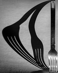 Duality discovered (donnicky) Tags: blackwhite closeup creative deformation duality fork kitchenware light madeofmetal publicsec shadow shape singleobject stilllife studioshot d850