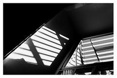 Modern Jail-Window (Thomas Listl) Tags: thomaslistl blackandwhite biancoenegro noiretblanc monchrome indoor window lightandshadow contrasts light mood dark jail prison anstalt lines geometry geometric graphical abstract diagonal 50mm