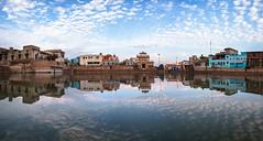 Radhakund Panorama - Takumar 28mm 3.5 (thomas.pirolt) Tags: water landscape reflection panorama sky sony a7ii india theindiatree takumar smc 28mm 35 radhakund blue clouds temple lake