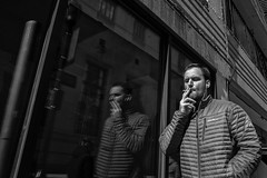 Chestnut Street, 2018 (Alan Barr) Tags: philadelphia 2018 chestnutstreet cigarette reflection mirrorimage street sp streetphotography streetphoto blackandwhite bw mono monochrome candid city people ricoh gr