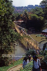Java, Bogor, wooden bridge (blauepics) Tags: indonesia indonesien southeast asia asien südostasien java island insel bogor city stadt landscape landschaft clouds wolken architecture architektur tropical tropisch river fluss water wasser 1995 wooden bridge hölzerne brücke