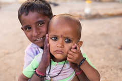 Namaste! Indian Child Portraits (Geraint Rowland Photography) Tags: eyes headshots portraits children cute religion indians hindu namaste wwwgeraintrowlandcouk jasialmer funportrait worldtravel peopleoftheworld youngsters geraintrowlandphotography jaisalmer peopleofrajasthan rajasthan