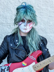 Masked Guitar Playing Cosplayer (J Wells S) Tags: cosplayer mask guitar leatherjacket animaticcon costume dressup portrait candidportrait holidayinneastgate eastgate cincinnati ohio