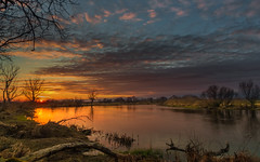 Early spring calm (piotrekfil) Tags: nature landscape sunset sun evening twilight dusk water river sky clouds reflections riverside trees pentax poland piotrfil