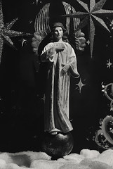 Angel Standing on The Earth (Anthony Mark Images) Tags: angel standingontheearth clouds stars art sculpture figure wings monochrome blackandwhite bronners christmaswonderland frankenmuth michigan usa windowdisplay nikon d850 lovely beautiful
