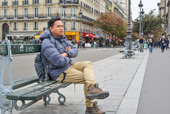 A man sitting on vintage bench (phuong.sg@gmail.com) Tags: asian background bench boy bridge casual chinese city coat cold communication concept cool crowded device guy hand handsome lifestyle looking male man modern one outdoor paris park people person portrait reading shoes sitting smart stoneroad street student taiwan tourist travel traveler urban vietnamese young