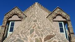 Bellsguard  : the dragon's eyes and nose (chriskatsie) Tags: dragon oeil yeux nez maison chateau espagne spain espana architecture gaudi window fenetre ciel sky