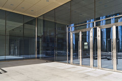 Closed doors in modern large glass building (Glasso) Tags: building door architecture entrance structure exterior doorway front home detail contemporary house business facade floor wall accessibility concept office design outdoor new construction metal closed gate steel background nobody mansion image feature glass doorstep urban enter photography corporate object shiny retail center mall trade crisis gates exit welcome bank