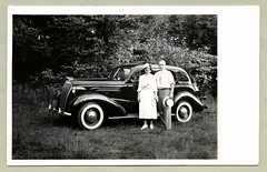 "1937 Chevrolet Master De Luxe (Vintage Cars & People) Tags: vintage us usa america vintageusa classic black white ""blackwhite"" sw photo foto photography automobile car cars motor vehicle antique auto lady woman girl blinde fashion dress hat shirt tie strawhat boater chevrolet chevy 1937 chevroletsedan 1930s thirties whitewalltyres sidewalltires whitewalls"