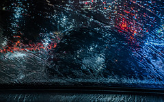 warm and dry waiting in the car (pbo31) Tags: bayarea eastbay alamedacounty nikon d810 color night dark black rain wet storm boury pbo31 urban city march 2019 oakland lakemerritt roadway blur reflection window car blue red