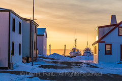 Boats and Buildings in Hólmavík in Westfjords of Iceland (Lee Rentz) Tags: atlantic europe harbour hólmavík iceland icelandic strandir westfjords architecture atlanticocean boats buildings city coast cold corrugated early fishing harbor horizontal industry isolated landscape light march morning nature ocean port remote road sea settlement snow snowcovered snowy street streetscape structures sun sunlight tourism tourists town travel traveling village weather winter witchcraft