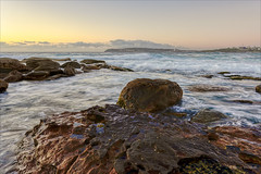 Wild and woolly (JustAddVignette) Tags: australia clouds copyspace dawn early headland landscapes newsouthwales northcurlcurl northernbeaches ocean rocks seascape seawater sky sun sunrise swell sydney water waves
