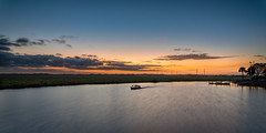 Let's get an early start... (Ed Rosack) Tags: usa sunrise riverscape dawn ©edrosack panorama powerlines clear dock multipleexposure cloud landscape centralflorida sky boat florida fishingboat cocoa waterscape cloudy us