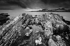 Isle of Whithorn Rocks (andy_AHG) Tags: isleofwhithorn scotland galloway wigtownshire northernbritain outdoors rural countryside history legend folklore nikond300s beach bay sand rocks shore sea tide solwayfirth irishsea rock sky landscape ocean monochrome