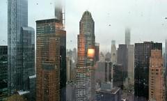 Bright lamp, Small drops, Big city (Robert Saucier) Tags: newyorkcity newyork nyc manhattan building architecture brume fog pluie rain raindrops gouttes fenêtre window vitre glass cristal reflet reflection lampe lamp residenceinn gratteciel skyscraper skyline img3607