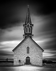 St. Olaf's Kirke (Church) 1886 (Mike Schaffner) Tags: bw blackwhite blackandwhite bulb canontse24mmf35lii chapel church cross historic historicsite historicalmarker kirke limestone longexposure monochrome norway norwegian rockchurch steeple tiltshift