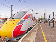 The new Azuma train. (jack cousin) Tags: azuma lner uk york yorkrailwaystation yorkshire architecture building cab cabin cables canopy carriage carriages clean colour colourful columns electriccables exterior futuristic lamps lights metalwork modern new ornatedecorative overheadcables platform polished railroad rails railway red reflection sleek stanchion station train transport transportation travel windows wiper yellow nikond610