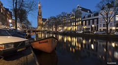 Amsterdam. (alamsterdam) Tags: amsterdam city westertoren canal prinsengracht evening longexposure reflection architecture boat cars bikes water sky