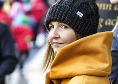 Looking my way (Frank Fullard) Tags: frankfullard fullard candid street portrait looking mustard hat cap beanie face expression lady beauty smile hair castlebar mayo irish ireland parade stpatrick holidat national