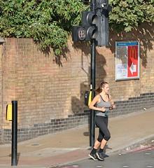 Lewisham Runner (Waterford_Man) Tags: girl run runner running jog jogger jogging london people path candid street electronic