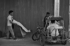 Portable Bed (Beegee49) Tags: street people man carrying cardboard bed blackandwhite monachrome bw sony bacolod luminar city philippines asia a6000