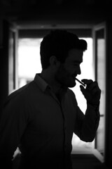 Paris (France, 2019) (theodirector) Tags: contraste contrast contrejour backlight silhouette silhouettes silhouetteart blackandwhite black whiteandblack noiretblanc window windows smoker smokinh smoking smokers cigarette cigarettebreak cigarettes paris parislife parisianpeople parisian parisianlife parisstyle pariscity parisien polar mysterious youngman