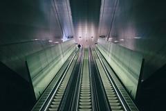 Rise. (Eric Flexyourhead) Tags: rokin centrum amsterdam netherlands holland nederland city urban station metro underground escalator sonyalphaa7 zeisssonnartfe35mmf28za zeiss 35mmf28