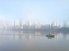 Foggy call (marktmcn) Tags: dogs isle police boat light craft foggy bright morning river thames london smooth calm wake trail water sky canary wharf buildings