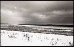 Near Salmistu, Estonia. (Dmitry Yurchenko) Tags: salmistu estonia harjumaa agfaapx400 film canoneos30 winter balticsea darkness landscape frozensea island umblu clouds storm