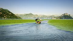 Accross the Skadar Lake (cedant1) Tags: montenegro lake skadar water europe boat tourist mountains blue shkodra landscape sky green nikon d5100