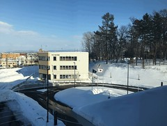 Panning Through a Panoramic View, Animated GIF (sjrankin) Tags: 18february2019 edited kitahiroshima hokkaido japan snow ice weather sky cityhall clouds buildings parkinglot cars roads stores