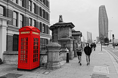 Shorts? (Geoff Henson) Tags: man woman telephone telephonebox colourpopping selectivecolours shorts bridge traffic people tower skyscraper pavement sidewalk road