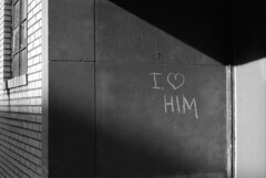i-love-him (kaumpphoto) Tags: mamiya nc1000s ilford 3200 bw black white wall shadow street urban city minneapolis heart love declaration statement brick chalk graffiti line intersect window drawing angle geometric