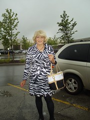 Isn't It A Lovely Day To Get Caught In The Rain :) (Laurette Victoria) Tags: stripedcoat mall laurette woman blonde