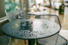 Film at its best (Geza (aka Wilsing)) Tags: 35mmlens analog bokeh dof fujicolorc200 nikonelii rain table