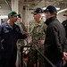 Sailors meet with Task Force 70 leadership during a visit to the USS Barry