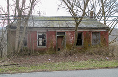 Mouser House — Ripley, Ohio (Pythaglio) Tags: house dwelling residence historic ripley ohio unitedstatesofamerica us 15story brick fivebay doublepile german mouser abandoned vacant overgrown browncounty hillside trees slope transom rakeboards 11windows sills