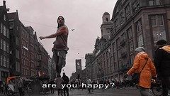 are you happy? (Mattijn) Tags: people crowd train station city amsterdam travel surreal forest videoart musicvideo piano song crawling dance
