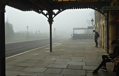 Down by the Station Early in the Moening.... (jenichesney57) Tags: station greatmalvern erly morning mist pillars wroughtironwork bikeshed gaslamp people silhouettes shapes ornamental panasoniclumixtz60 platform paving benches train tracks atmospheric