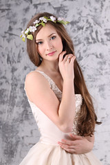 Beautiful young woman in wreath with long hair poses in white studio (singulyarra) Tags: adult arms attractive beautiful beauty brunette caucasian chin cute dream dress elegance elegant eyes face fashion female flowers fresh girl hair hands lady lashes lifestyle long lovely make makeup model one person portrait posing pretty romantic shoulders skin skincare slim spring studio style wall white woman wreath young